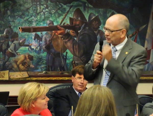 State Rep. John Wood, R-Winter Haven, proposed an amendment that would let lawmakers with concealed-carry licenses pack heat during legislative meetings and on the House floor.
