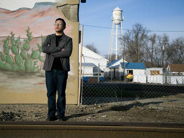 Ismael Fernandez, College of Idaho freshman and newly elected city councilman for the city of Wilder, Idaho, stands by an abandoned railroad track near the center of town. Fernandez will join three other City Council members in Wilder to form the first all-Latino city council in Idaho history.