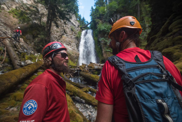 """<p>The safety and rigging team, Jared Smith, left, and Mike Williams, right, standbelow the waterfall nicknamed """"NE Shangri-La.""""</p>"""