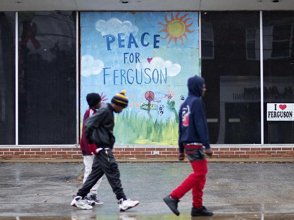 A mural depicting peace in Ferguson was painted on the wall of a vacant building near the city's police department.