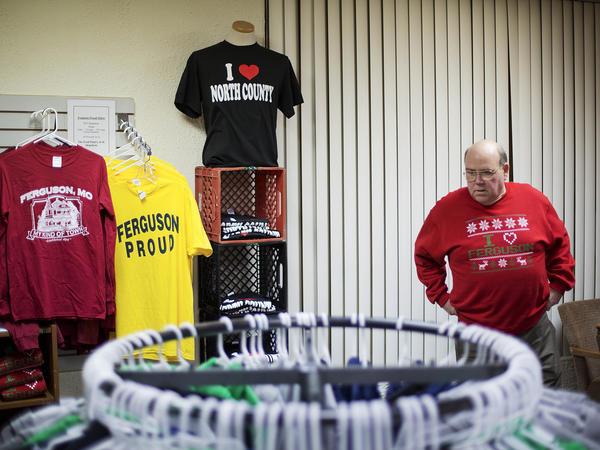 Former Ferguson Mayor Brian Fletcher volunteers in the store selling I Love Ferguson committee paraphernalia.