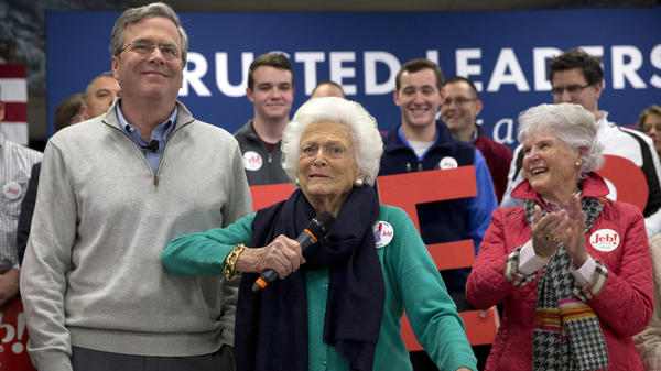 Barbara Bush jokes with her son, Republican presidential candidate Jeb Bush, while introducing him at a town hall meeting in Derry, N.H.