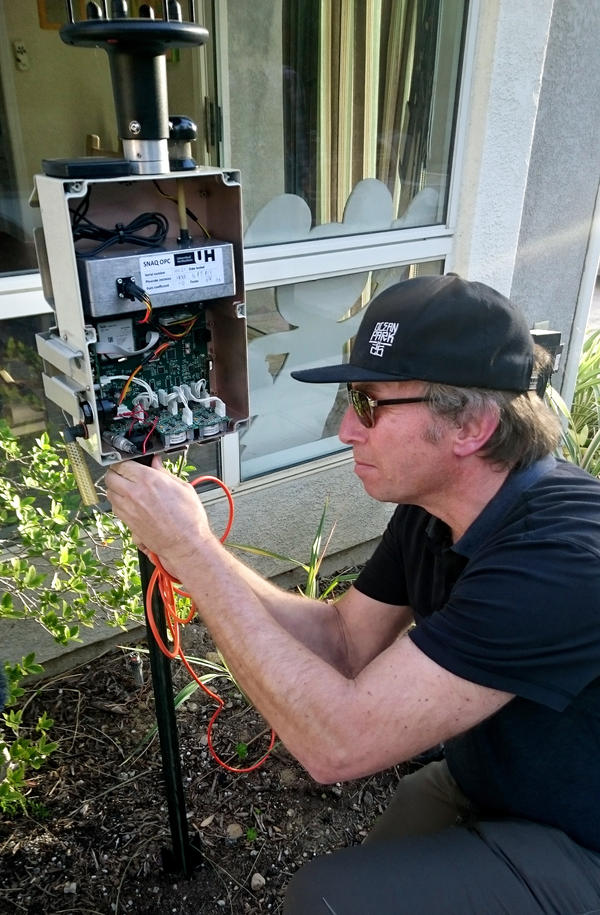 UCLA environmental health researcher Michael Jerrett checks one of the sensors he's placed throughout Porter Ranch. It's checking for a number of air contaminants, including benzene and hydrogen sulfide, as well as temperature and wind direction.