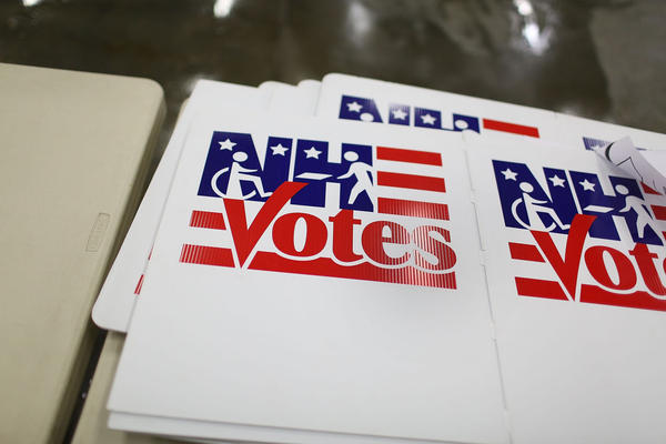 Votes signs are seen at the Newmarket Fire and Rescue station in preparation for Tuesday's primary voters in New Hampshire. (Joe Raedle/Getty Images)