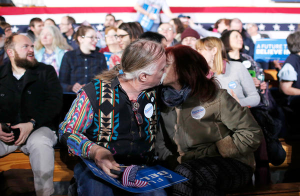 John Gurney and Lisette Lux, both supporters of Sen. Bernie Sanders, kiss while waiting for the Democratic presidential candidate's watch party to begin in Concord.