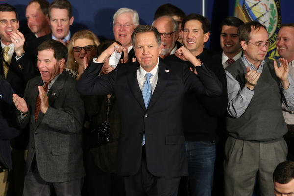 Republican presidential candidate John Kasich arrives onstage at a campaign gathering with supporters after placing second in the New Hampshire Republican primary in Concord, N.H.