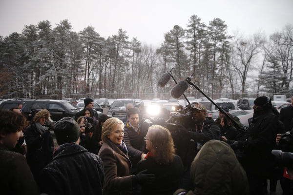 Hillary Clinton campaigns outside a polling place in Manchester. She lost by a larger-than-expected 22-point margin to Bernie Sanders, the winner of Tuesday's Democratic primary.