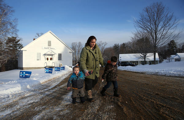 Sarah Stickney leaves the town hall with her sons after casting her ballot in Canterbury.