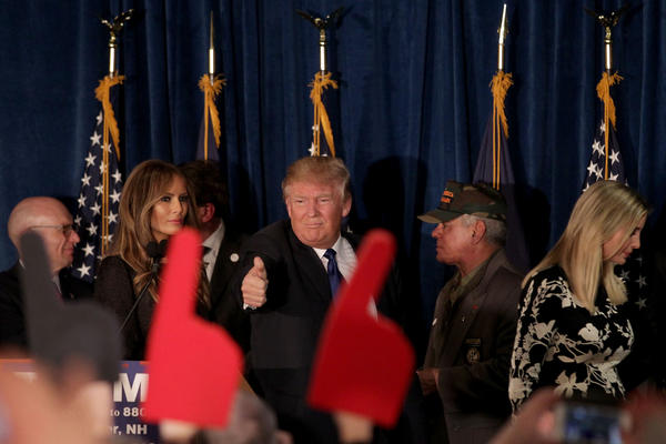 Donald Trump walks off stage after speaking at his election night watch party at the Executive Court Banquet Facility in Manchester.
