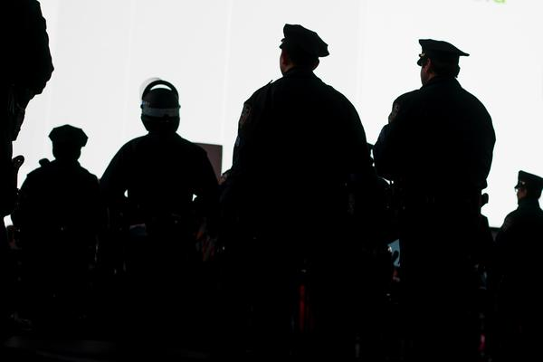 New York City Police officers watch demonstrators protesting the death of Eric Garner near Times Square.