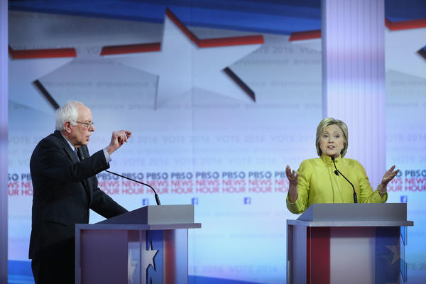 Bernie Sanders and Hillary Clinton participate in the PBS <em>NewsHour</em> Democratic presidential candidate debate Thursday at the University of Wisconsin, Milwaukee.
