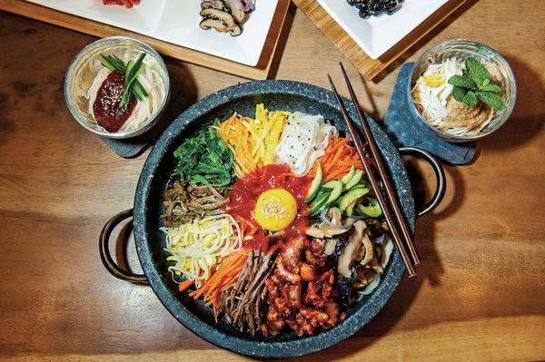 "Bibimbap is one of the best-known Korean dishes. According to chef Deuki Hong and writer Matt Rodbard, there really isn't a definitive recipe. ""The name translates to 'mixed rice,' and, in practice, rice is the dish's only constant,"" the authors write in their new cookbook, <em>Koreatown.</em>"