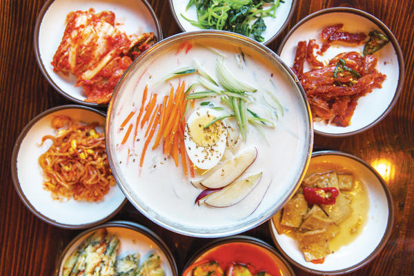 In their cookbook, Rodbard and Hong intentionally focused more on soups and stews, which they call the heart of Korean cooking. Above, a bowl of <em>kongguksu</em>, a cold soup traditionally served in the summertime and made with soy milk, thin somen wheat noodles and pine nuts.