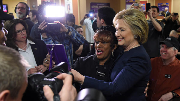Hillary Clinton takes photos with workers during a visit to Harrah's Las Vegas on Saturday.