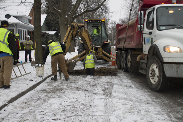 Crew members in Lansing get closer to the lead service line they plan to remove.