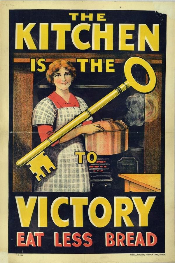 "A British propaganda poster from World War I reminds consumers that ""The Kitchen is the Key to Victory. Eat Less Bread."""