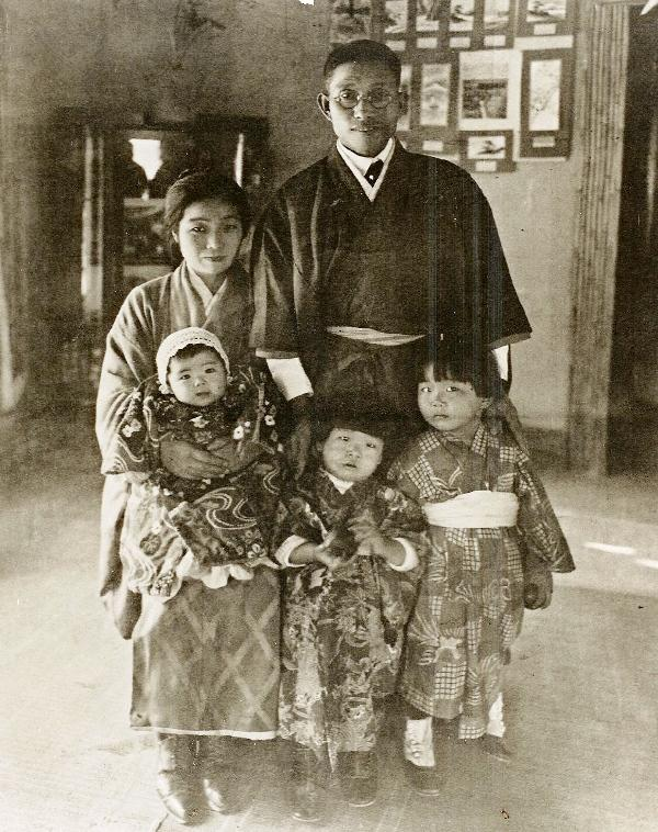 Jingu family early on in their home