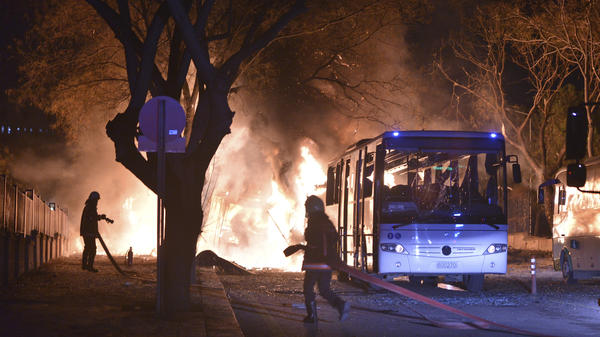 Firefighters work at the scene of a deadly explosion Wednesday in Ankara, Turkey.