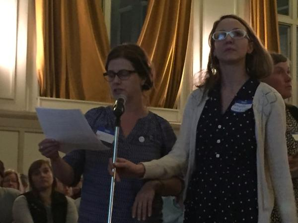<p>Jessica Applegate and Amanda Jarman deliver their demands for more stringent air pollution controls to public officials at an open house Tuesday in Portland.</p>