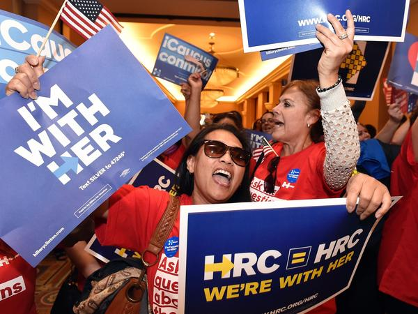 Naomi Barnes (left) shows her support for Democratic presidential candidate Hillary Clinton during the Nevada caucus in Las Vegas.