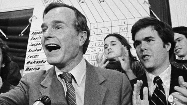 George Bush claims victory in the 1980 Iowa caucuses, with his son Jeb at his side. Jeb Bush would fail in his bid for the White House 36 years later.