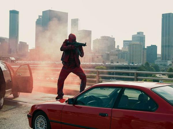 Armed thieves make their getaway on the Atlanta freeway in <em>Triple 9</em>.