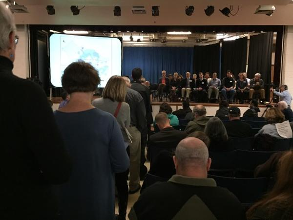 <p>Officials take questions from a large audience at Harriet Tubman Middle School Thursday.</p>