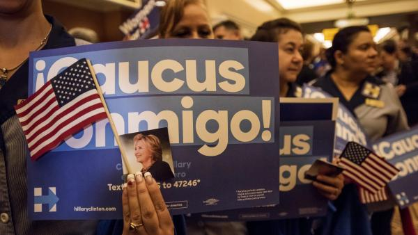 """Caucus conmigo"" (""Caucus with me"") signs were a common sight at Clinton events in Nevada."