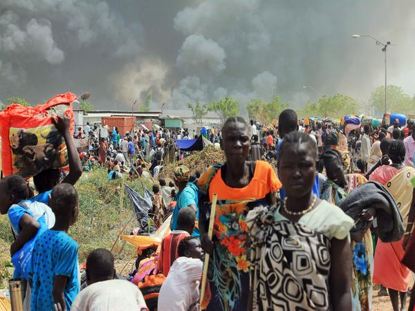 South Sudanese civilians flee fighting in the northeastern town of Malakal on February 18, 2016, where gunmen opened fire on civilians sheltering inside a United Nations base.