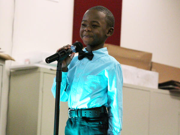 """College Prep student Troy Brumfield recites the poem, """"Hey Black Child"""" by Countee Cullen."""
