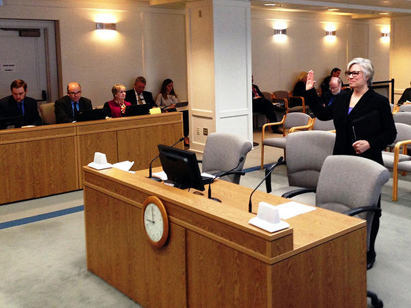 Former Department of Corrections Assistant Secretary Denise Doty is sworn in before testifying before a Washington state Senate panel investigating the early release of nearly 3,000 inmates.