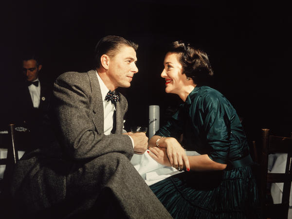 Actor Ronald Reagan and his wife, Nancy, gaze at one another across a table in 1952. <strong></strong>