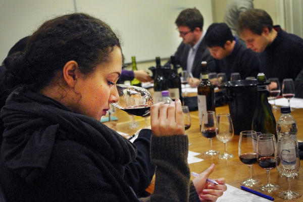 An Oxford student practices for the upcoming wine-tasting match with the University of Cambridge.