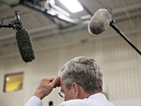 Jeb Bush pauses during an event at La Casa de Esperanza in Waukesha, Wis., in November.