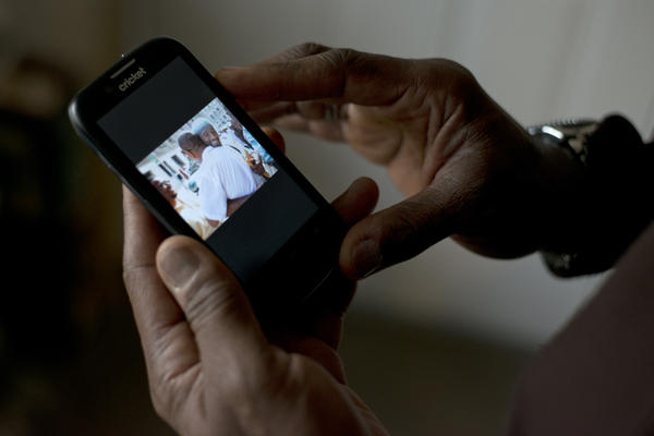 El-Amin shows a photo of his release from prison. Now 60 years old, he served 42 years in prison for murder before he was freed on probation in 2013.
