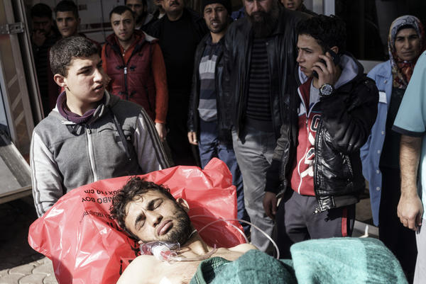 A wounded Syrian man is carried to a hospital in Kilis, Turkey, just across the border from Syria, last month. The protests against Syrian President Bashar al-Assad began five years ago this month, evolving into a multi-sided civil war.