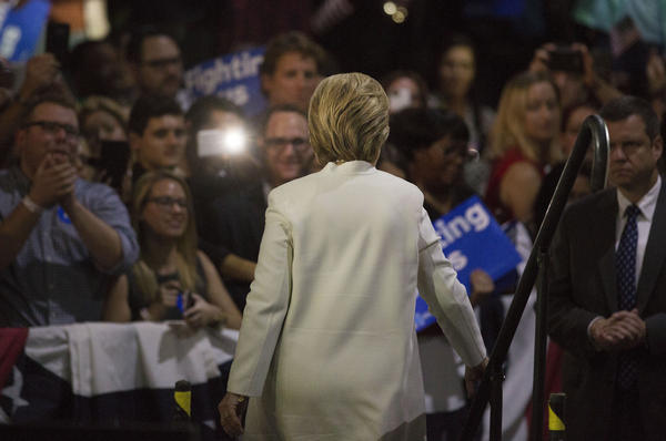 Hillary Clinton exits the stage after speaking during a Super Tuesday night rally in Miami.