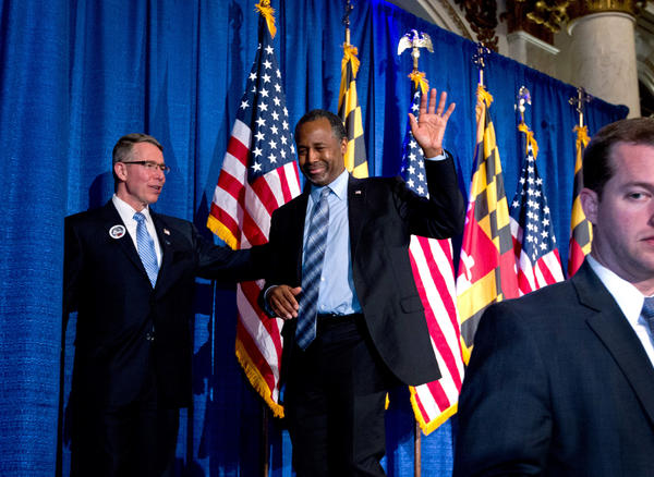 Republican presidential candidate Ben Carson waves to supporters during an election night party in Baltimore.