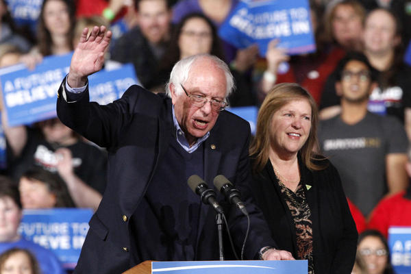Bernie Sanders, with his wife Jane Sanders, waves as they arrive to a primary night rally in Essex Junction, Vt. on Tuesday. (Jacquelyn Martin/AP)