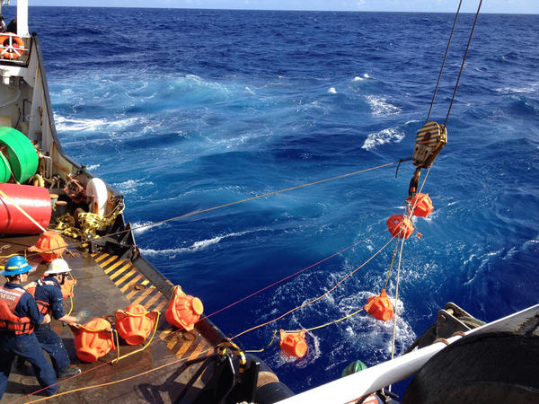 Deployment of the deep-ocean hydrophone with its retrieval moorings from the deck of the USCG Cutter Sequoia at Mariana Trench.