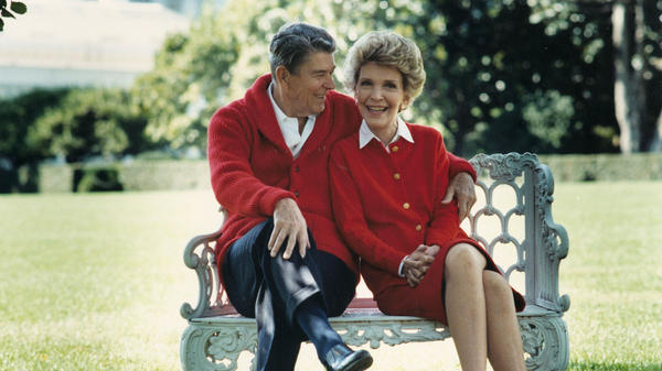 Former U.S. President Ronald Reagan and first lady Nancy Reagan share a moment in this undated file photo.