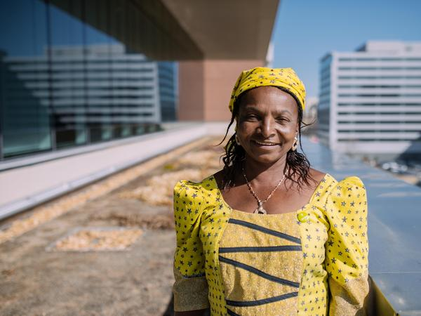 "Monica Maigari, a <em>Female Food Heroes</em> contestant from Nigeria, is visiting Washington, D.C., for the first time on a trip sponsored by Oxfam. She says NPR's rooftop garden, where she is pictured, is ""great for carrots and tomatoes."""