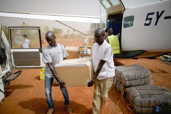 Doctors Without Borders hospital staff unload supplies from one of their planes at the Bentiu airport. All of the hospital supplies, including fuel for the generators, are flown in. South Sudan's roads are unpassable because they've fallen into disrepair or are unsafe due to civil war violence.