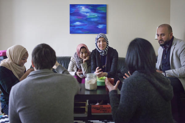 A group of young Muslim friends in Washington, D.C., meets occasionally to support each other in their work and discuss the struggles their community faces.