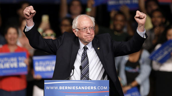 Democratic presidential candidate and Vermont Sen. Bernie Sanders acknowledges his supporters at a campaign rally Tuesday in Miami.