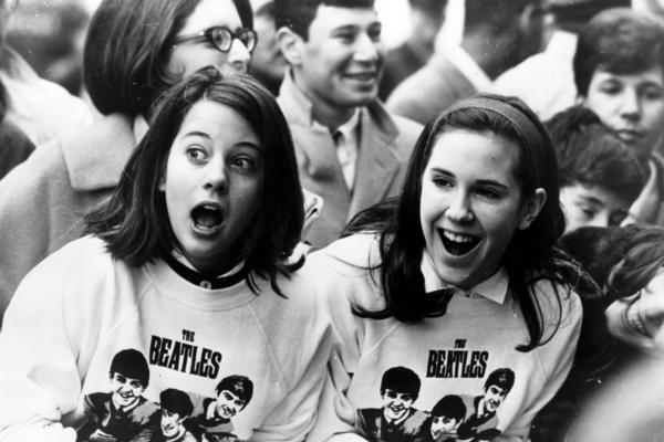 Beatles fans in New York welcome the group to the U.S. on Feb. 10, 1964. Music critics agree that the band wouldn't have been the Beatles we know without Martin.