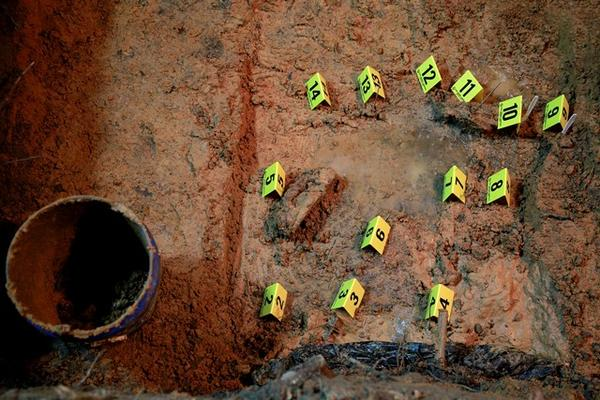 Evidence markers in a suspected grave in the Boot Hill cemetery on the grounds of the Dozier School for Boys in 2013.