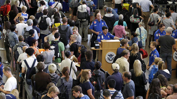 Lines of travelers snake past TSA agents at the Seattle-Tacoma International Airport last fall.