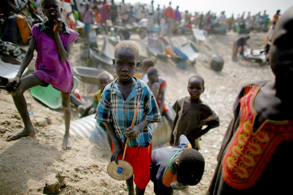 Hundreds of thousands of South Sudanese have fled their homes because of the ongoing civil war. (Above) Kids at a displaced persons camp in Bentiu. Many of the residents came from the part of South Sudan where the shipping container massacre reportedly occurred.