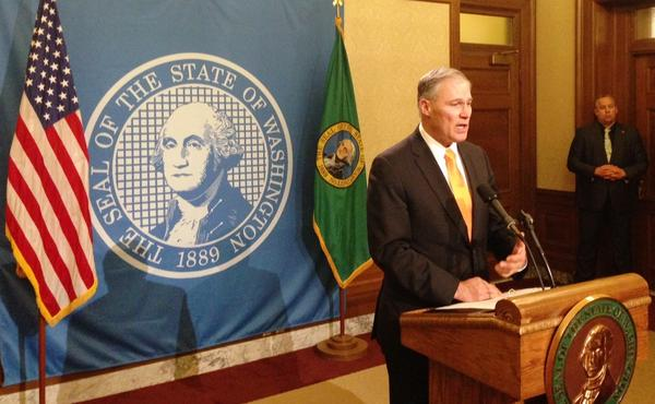Washington Gov. Jay Inslee addresses reporters after vetoing 27 bills after lawmakers failed to reach a budget deal before the end of the regular 60-day legislative session.